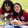 PocSC interns, Stephanie and Lian, enjoying some fried bread at Drum Feast 2018